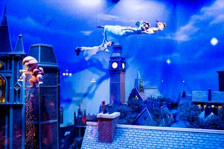 """Peter Pan and the Darling children, Wendy, John and Michael, fly above London's rooftops in this scene inside one of the Emporium's windows facing Main Street, U.S.A. at Disneyland. The newly installed (in 2015) window displays feature new animated Disney characters and special effects. Each window changes periodically between two different scenes.  //// ADDITIONAL INFORMATION: Disneyland installed new """"enchanted"""" store front windows along Main Street, U.S.A. at the Emporium.   -  Disney.EnchantedWindows- Date of photo: 8/25/15 - MARK EADES, STAFF PHOTOGRAPHER"""
